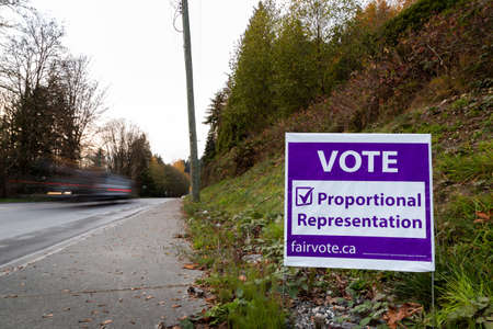 NORTH VANCOUVER, BC, CANADA - NOV 08, 2018: Signage on Dollarton Highway reminding citizen to vote in BCs electoral reform referendum for proportional representation.