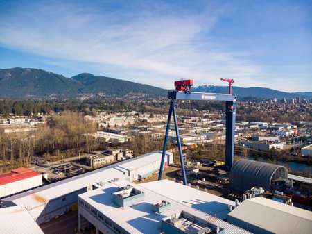 NORTH VANCOUVER, BC, CANADA - JAN 13, 2019: Large industrial seaspan crane at the port in North Vancouver.