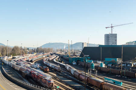 NORTH VANCOUVER, BC, CANADA - JAN 13, 2019: A view of the trainyard and resource terminal in North Vancouver.