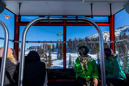 WHISTLER, BC, CANADA - JAN 14, 2019: Inside a gondola car of the the Peak 2 Peak gondola looking towards Blackcomb. Editorial