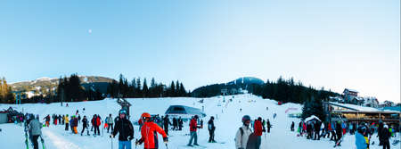 WHISTLER, BC, CANADA - JAN 14, 2019: A view of skiers coming down the hill as seen from Whistler village.
