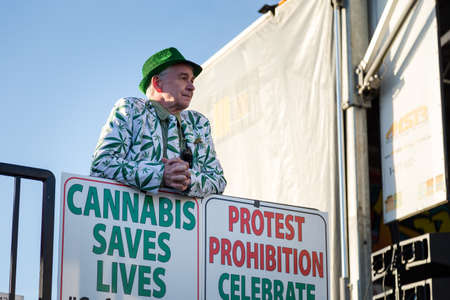 VANCOUVER, BC, CANADA - APR 20, 2019: A marijuana activist standing by a pro-marijuana sign at the 420 festival in Vancouver. Editorial