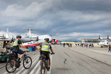ABBOTSFORD, BC, CANADA - AUG 11, 2019:: A RCMP officers patrol at the Abbotsford International Airshow.