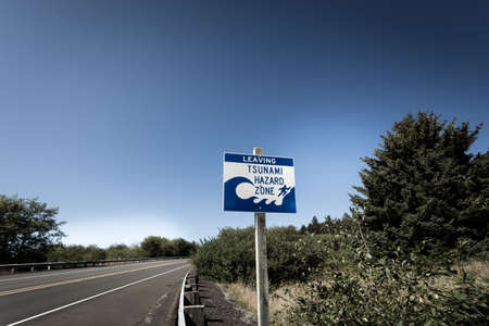 A tsunami warning sign along a coastal highway near the Oregon coast.