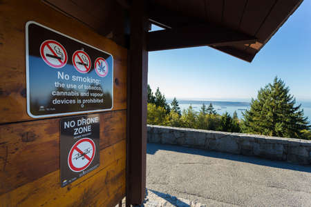 VANCOUVER, BC, CANADA - OCT 10, 2019: A sign indicating the restriction of cannabis products and cigarettes as well as the prohibition of the use of drone on Cypress Mountain