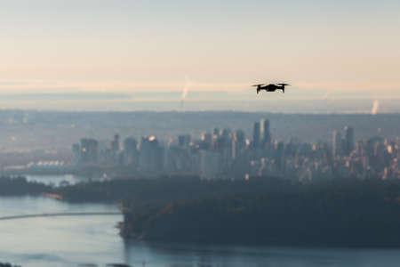 A small consumer drone overlooking the city of Vancouver