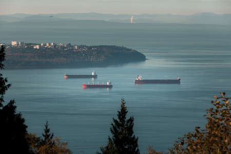 Cargo ships anchored in Burrard Inlet near Point Grey in Vancouver, BC Stock fotó