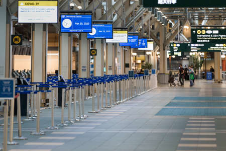 RICHMOND, BC, CANADA - MAR 29, 2020: International departures section of YVR which is nearly empty due to the COVID-19 coronavirus pandemic.