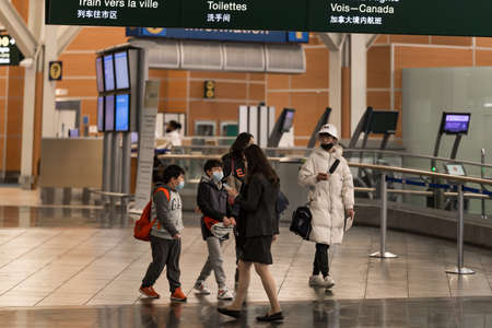 RICHMOND, BC, CANADA - MAR 29, 2020: Travellers in the international departures section of YVR which is nearly empty due to the COVID-19 coronavirus pandemic.
