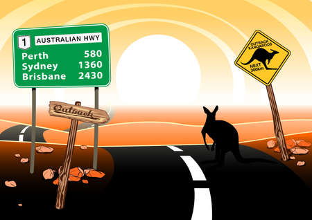 km: Kangaroo standing on road in the Australian outback.