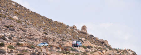 coche: cars on a mountain road Stock Photo