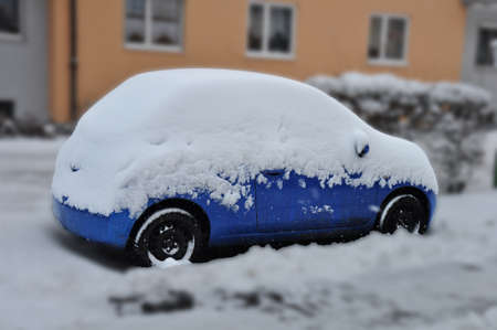 powder snow: car covered with snow