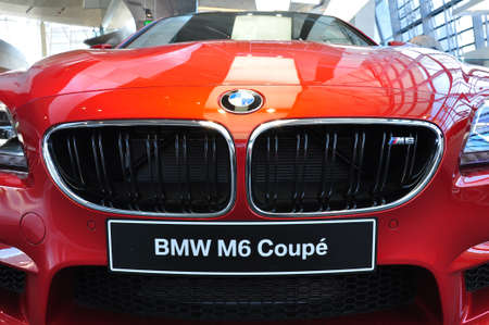 MUNICH, DECEMBER 11  front of a BMW M6 Coupe at BMW Car Show on December 11, 2012 in Munich, Germany