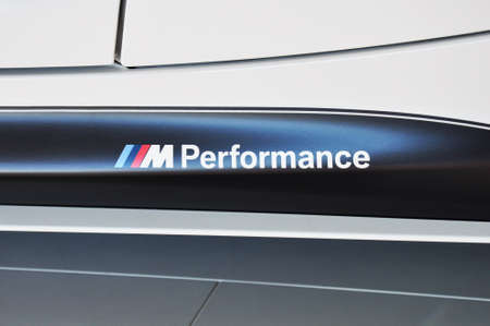coche: MUNICH, DECEMBER 11: BMW M-Performance Logo at BMW Car Show on December 11, 2012 in Munich, Germany Editorial
