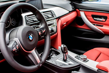 luxus: Deggendorf, Germany - 23. APRIL 2016: red leather interior of a 2016 BMW 4 Gran Coupe during the luxury cars presentation in Deggendorf.