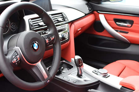 Deggendorf, Germany - 23. APRIL 2016: red leather interior of a 2016 BMW 4 Gran Coupe during the luxury cars presentation in Deggendorf.