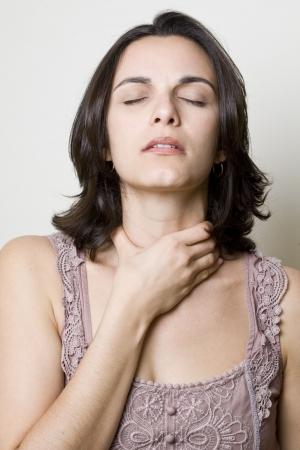 aching: Sore Throat woman Stock Photo