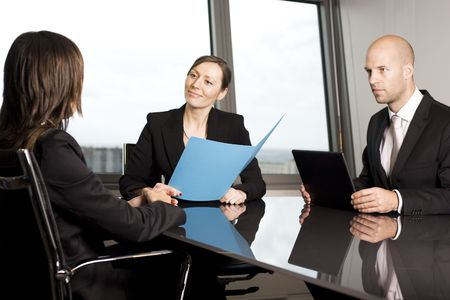 Young woman having a job interview in a beautiful office Stock Photo