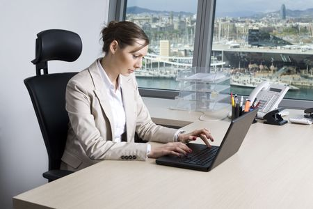 revision: Businesswoman in office in Barcelona Stock Photo