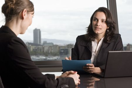 job satisfaction: Young woman having a job interview in a beautiful office Stock Photo