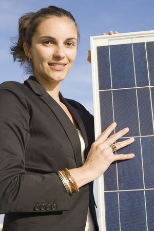 Young woman with  a solar panel Stock Photo - 5019799