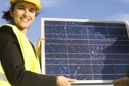 Young woman with  a solar panel Stock Photo