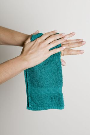Drying hands with a towel photo