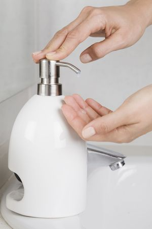 Putting some soap on hands photo