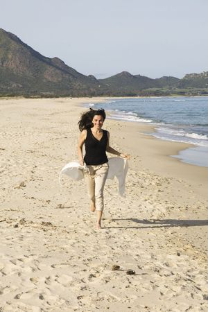 Woman running on the beach Stock Photo - 6782474