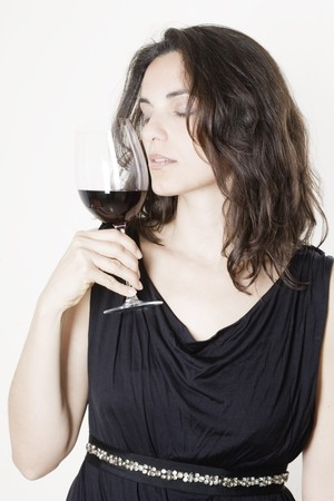 Pretty young woman tasting wine photo