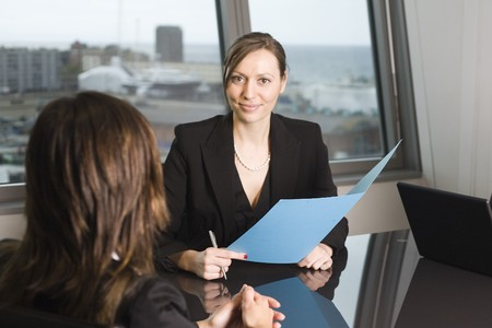 Woman looking for a job sitting in a job interview