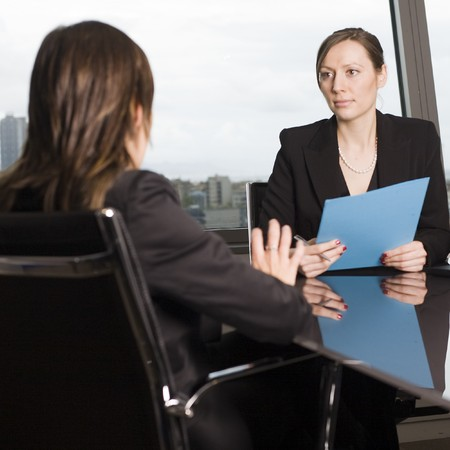 sacked:   Female boss dismisses a female worker in his office