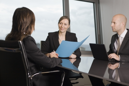 Woman consulting her lawyer on some law topics Stock Photo