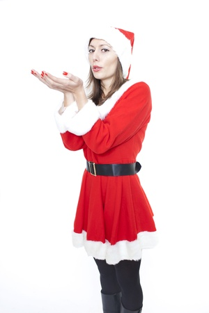 Christmas woman blowing air Stock Photo - 8397211