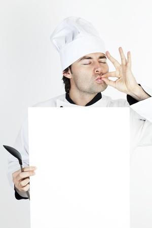 chef showing his restaurants menu photo