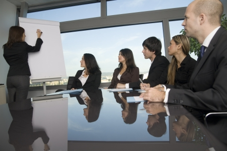 sales meeting: Business training in front of a panorama window