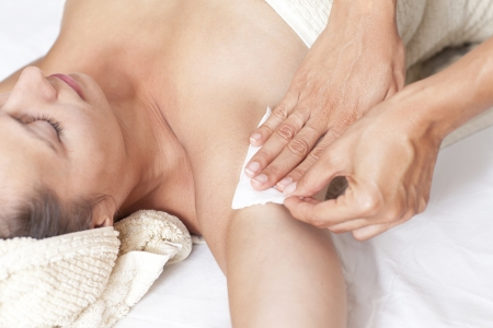 Female armpit depilation in a beauty salon
