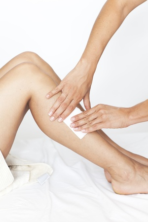 removal: Removing hair from woman's legs