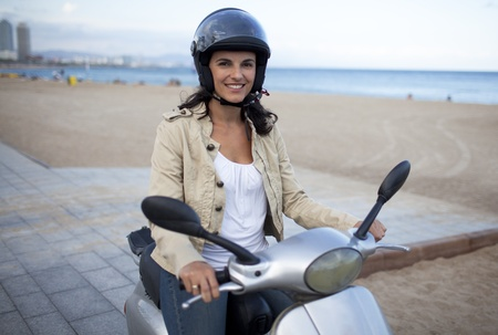 Attractive latin woman on a scooter photo