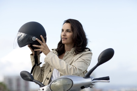 Attractive woman takes off her helmet photo