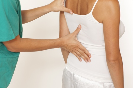 acupressure hands: Massage of shoulder Stock Photo