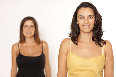 personable: Two women in a row out of focus