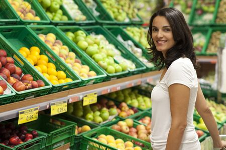 single shelf: Woman shopping in supermarket Stock Photo