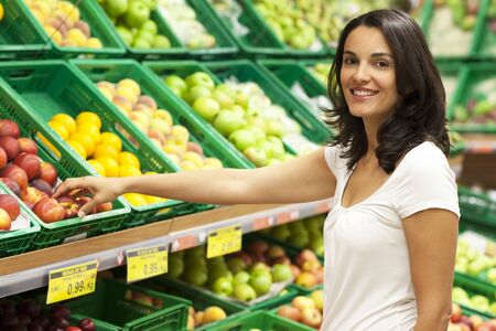 errands: Woman shopping in supermarket Stock Photo