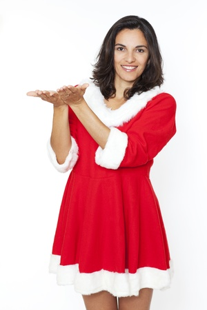 Christmas woman showing with hand open