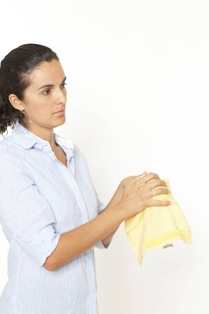 Woman drying hands with a towel photo