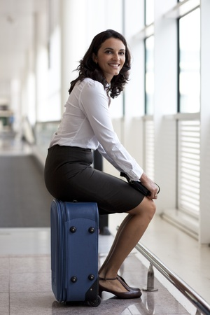 stewardess: Good-looking businesswoman waiting at the airport