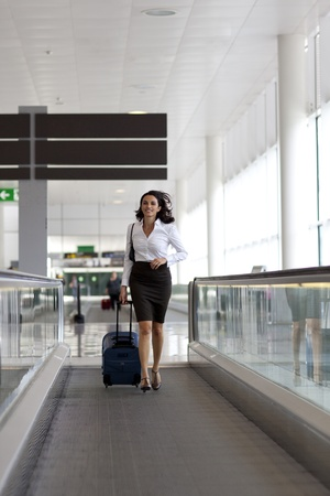 Businesswoman running at the airport photo