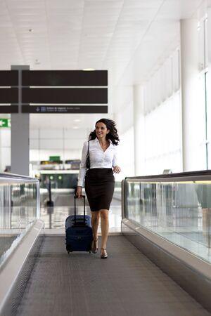 Latin woman running at the airport photo