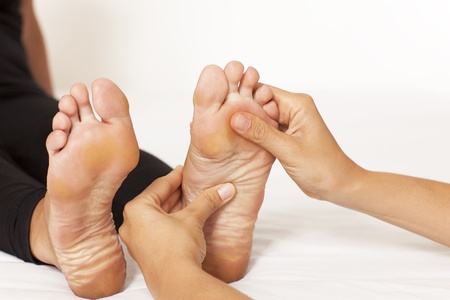 Human hands massaging a woman�s foot photo